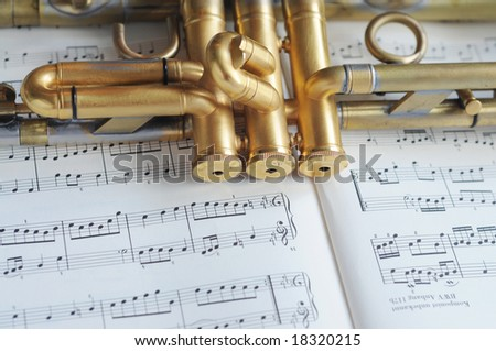 beautiful trumpet on sheet music