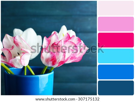 Beautiful tulips on wooden background and palette of colors - stock photo