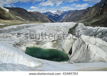 Beautiful turquoise glacial lake. Karator glacier. Kuylu mountains, Central Tien-Shan, Kyrgyzstan. - stock photo