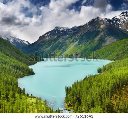 Beautiful turquoise lake in Altai mountains - stock photo