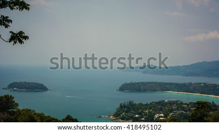 Beautiful turquoise ocean waves with boats and coastline from high view point. Kata, Karon and Patong beaches Phuket Thailand. - stock photo