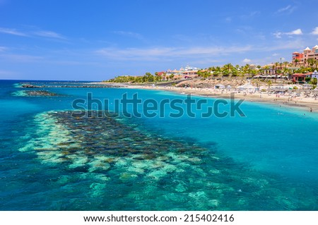 Beautiful turquoise sea water on El Duque beach, Tenerife, Canary islands, Spain  - stock photo