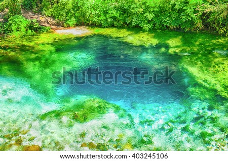 Beautiful turquoise spring Blue Eye (Syri i Kalter) near a town of Muzine, Albania. The spring is very powerful,  cold and deep and is a source of a river Bistrice - stock photo