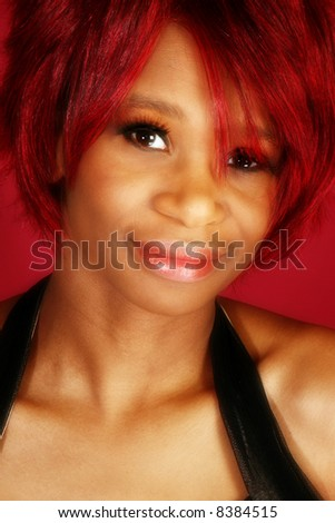Beautiful twenty something African American woman over red background. - stock photo