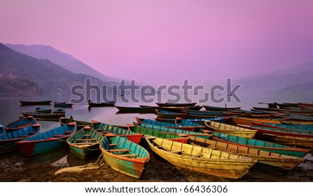 Beautiful twilight landscape with boats on Phewa lake, Pokhara, Nepal - stock photo