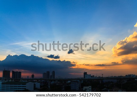 Beautiful twilight sky at sunset over a dark cityscape