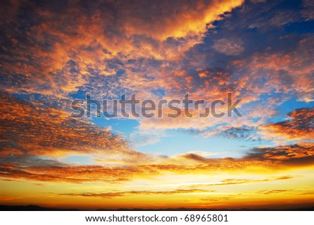 beautiful twilight sunrise scene on cloudy sky - stock photo