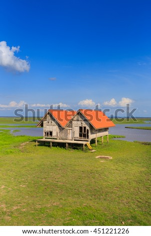 Beautiful twin hut at green field and blue sky ,Phatthalung ,Thailand