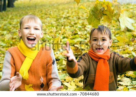 beautiful two boys together on the nature - stock photo