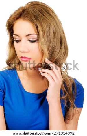 Beautiful unhappy woman looking down. - stock photo