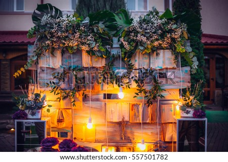 Beautiful unusual wedding decor rustic style stock photo royalty beautiful unusual wedding decor rustic style bench wall of flowers lanterns junglespirit Image collections