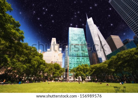Beautiful upward view of Skyscrapers in Bryant Park, New York. - stock photo