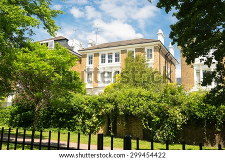 Beautiful urban building surrounded by a park in London - stock photo