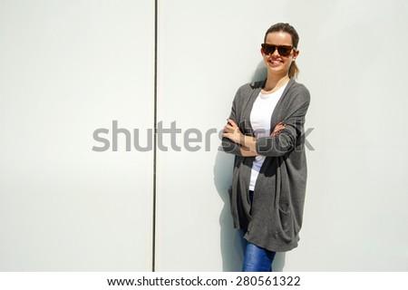 Beautiful urban woman, girl smiling in the city - stock photo