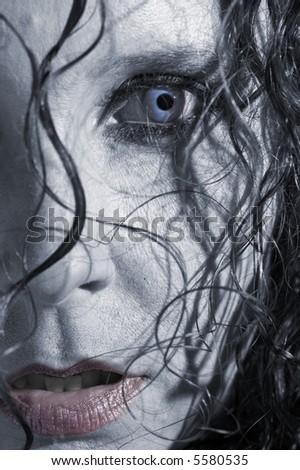 Beautiful vampiress close up - stock photo