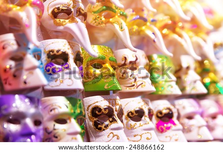 Beautiful Venetian masks background, sales of many gorgeous decorated carnival masque for man, luxury masquerade accessories - stock photo