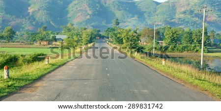 Beautiful Vietnamese countryside landscape, way forward chain of mountain in morning, field along highway, fresh environment, eco green, street like goal or target