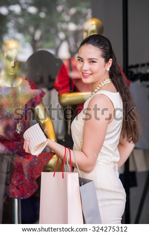Beautiful Vietnamese woman in front of clothing boutique