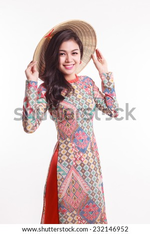 Beautiful Vietnamese young woman with modern style ao dai and palm-leaf conical hat ( non la ) on white background - stock photo