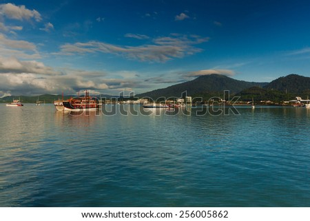 Beautiful view at Langkawi Island sea with ships and boats carrying passenger from Malaysia Peninsular came to the island. - stock photo