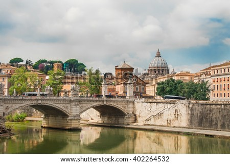 Beautiful view at Ponte Sant'Angelo (in front) and St.Peter's Basilica (behind) in Rome, Italy. - stock photo