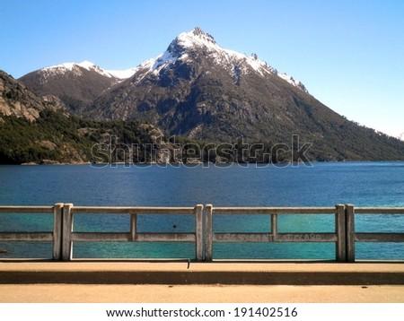 Beautiful view landscape mountain bridge lake Patagonia. - stock photo