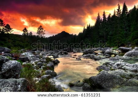 Beautiful view of a mountain river at sunset - stock photo