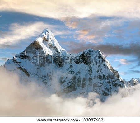 Beautiful view of Ama Dablam with and beautiful clouds - Sagarmatha national park - Khumbu valley - Trek to Everest base cam - Nepal - stock photo