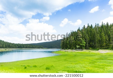 Beautiful view of blue lake and mountains - stock photo