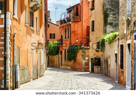 Beautiful view of colorful facades of old houses on street Calle Gradisca Cannaregio in Venice, Italy. Venice is a popular tourist destination of Europe. - stock photo