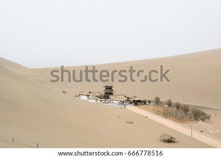 Beautiful view of Crescent moon Lake in Mingsha Mountain, the desert in Dunhuang, China