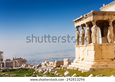 Beautiful view of Erechtheion with panorama of Acropolis in summer in Athens, Greece - stock photo