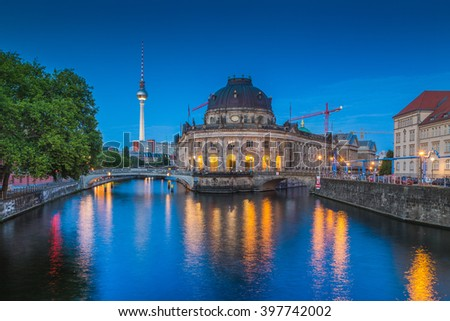 Beautiful view of famous Bode Museum at historic Museumsinsel (Museum Island) with TV tower and Spree river in twilight during blue hour at dusk, Berlin, Germany - stock photo