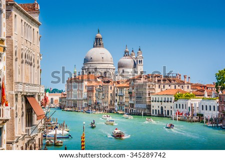 Beautiful view of famous Canal Grande with Basilica di Santa Maria della Salute in the background on a sunny day in summer, Venice, Italy