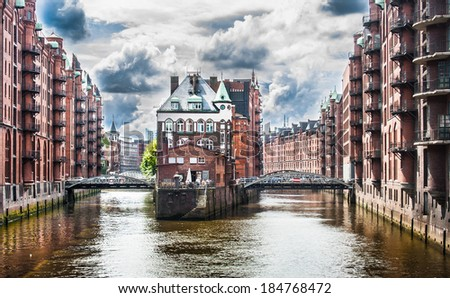 Beautiful view of famous Speicherstadt warehouse district with dramatic clouds before the storm in Hamburg, Germany - stock photo