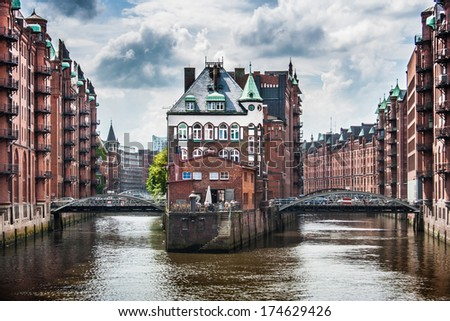 Beautiful view of famous Speicherstadt with dark clouds before the storm in Hamburg, Germany - stock photo