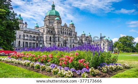 Beautiful view of historic parliament building in the citycenter of Victoria with colorful flowers on a sunny day, Vancouver Island, British Columbia, Canada - stock photo