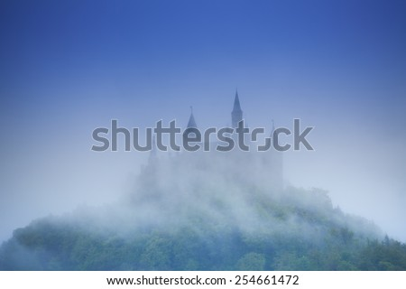 Beautiful view of Hohenzollern castle in haze - stock photo