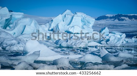 Beautiful view of icebergs in Jokulsarlon glacier lagoon, Iceland, selective focus, global warming and climate change concept - stock photo
