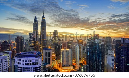Beautiful view of Kuala Lumpur city centre from a rooftop at sunrise - stock photo