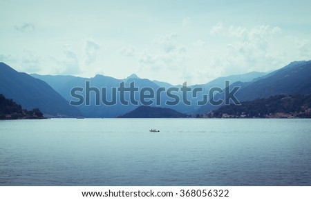 beautiful view of mountains disappearing into the distance at Lake Como in Italy - stock photo