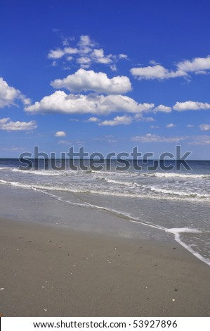 Beautiful view of ocean, sky and sand. Perfect for cover art or background. - stock photo