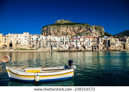 beautiful view of old boat drifting in a harbor at Cefalu Beach, Italy - stock photo