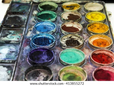 Beautiful view of paints and wooden brushes