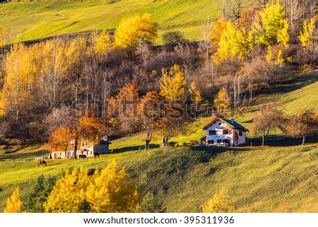 Beautiful view of peaceful house on the swiss alps in the autumn sunlight at dusk, Filisur, canton of Grisons, Switzerland. - stock photo
