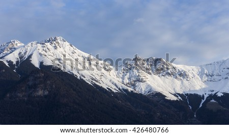 Beautiful View of the Austrian Alps Covered in Snow on Winter - stock photo