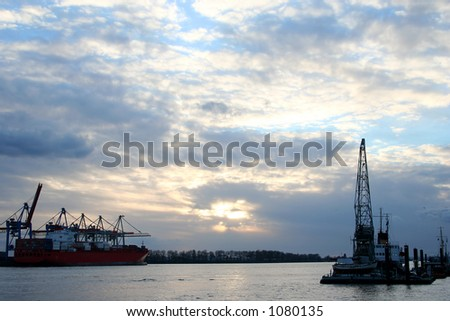 Beautiful view of the cranes and logistics at dawn in the  harbour of Hamburg, very peaceful - stock photo