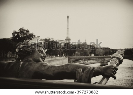 Beautiful view of the Eiffel Tower from the Concorde Bridge. View on Seine river, sculpture on Alexander III bridge in Paris, France. Black and white vintage photo. Retro travel picture sepia filter. - stock photo