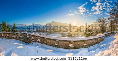 Beautiful view of the historic city of Salzburg and mountain landscape in in idyllic winter sunset setting, Salzburger Land, Austria - stock photo