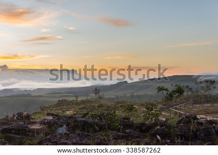 Beautiful view of the Kukenan tepuy at sunrise, from the Oso (Bear) viewpoint in Canaima National Park, Venezuela. - stock photo